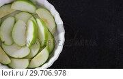 Купить «Slice of green apple on bowl 4k», видеоролик № 29706978, снято 5 мая 2017 г. (c) Wavebreak Media / Фотобанк Лори