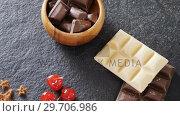 Купить «Chocolates and fruit on concrete background 4k», видеоролик № 29706986, снято 5 мая 2017 г. (c) Wavebreak Media / Фотобанк Лори