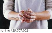 Купить «Woman molding a dough ball 4k», видеоролик № 29707002, снято 5 мая 2017 г. (c) Wavebreak Media / Фотобанк Лори