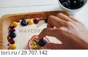 Купить «Fruit yogurt in plate 4k», видеоролик № 29707142, снято 13 июня 2017 г. (c) Wavebreak Media / Фотобанк Лори