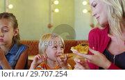 Купить «Mother and kids having pizza in restaurant 4k», видеоролик № 29707254, снято 28 марта 2017 г. (c) Wavebreak Media / Фотобанк Лори