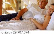 Senior couple lying on canopy bed 4k. Стоковое видео, агентство Wavebreak Media / Фотобанк Лори