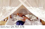 Senior couple sleeping on canopy bed 4k. Стоковое видео, агентство Wavebreak Media / Фотобанк Лори