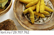 Купить «Turmeric raw seed, bay leaf and seed in bowl 4k», видеоролик № 29707762, снято 5 июня 2017 г. (c) Wavebreak Media / Фотобанк Лори