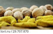 Купить «Nutmeg and turmeric stick on black background 4k», видеоролик № 29707870, снято 5 июня 2017 г. (c) Wavebreak Media / Фотобанк Лори