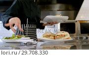 Купить «Female waitress inserting bill in bill pin stand 4k», видеоролик № 29708330, снято 21 мая 2017 г. (c) Wavebreak Media / Фотобанк Лори