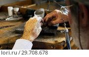 Купить «Goldsmith manufacturing jewellery in workshop 4k», видеоролик № 29708678, снято 10 июня 2017 г. (c) Wavebreak Media / Фотобанк Лори