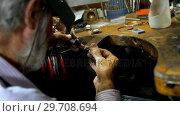 Купить «Goldsmith manufacturing bangle in workshop 4k», видеоролик № 29708694, снято 10 июня 2017 г. (c) Wavebreak Media / Фотобанк Лори