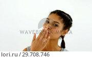 Woman giving flying kiss against white background 4k. Стоковое видео, агентство Wavebreak Media / Фотобанк Лори