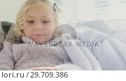 Купить «Little girl sitting on sofa stroking her pet cat 4K 4k», видеоролик № 29709386, снято 31 мая 2017 г. (c) Wavebreak Media / Фотобанк Лори