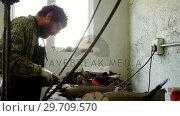 Купить «Craftsman working at workshop 4k», видеоролик № 29709570, снято 30 мая 2017 г. (c) Wavebreak Media / Фотобанк Лори