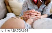 Купить «Cute little baby lying in the crib and mother putting pacifier in mouth 4k», видеоролик № 29709654, снято 8 ноября 2017 г. (c) Wavebreak Media / Фотобанк Лори