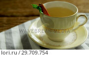 Купить «Herbal tea with cinnamon sticks and herb on a cloth 4k», видеоролик № 29709754, снято 12 июня 2017 г. (c) Wavebreak Media / Фотобанк Лори