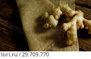 Купить «Ginger with textile on a wooden table 4k», видеоролик № 29709770, снято 12 июня 2017 г. (c) Wavebreak Media / Фотобанк Лори