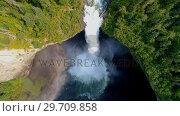 Купить «Beautiful water fall through forest cliff on a sunny day 4k», видеоролик № 29709858, снято 3 августа 2017 г. (c) Wavebreak Media / Фотобанк Лори