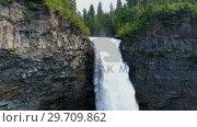 Купить «Beautiful water fall through cliff on a sunny day 4k», видеоролик № 29709862, снято 3 августа 2017 г. (c) Wavebreak Media / Фотобанк Лори