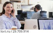 Купить «Female executive talking on phone while colleagues working in background 4k», видеоролик № 29709914, снято 3 сентября 2017 г. (c) Wavebreak Media / Фотобанк Лори