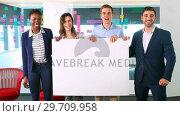 Купить «Portrait of business colleagues holding a blank banner 4k», видеоролик № 29709958, снято 19 августа 2017 г. (c) Wavebreak Media / Фотобанк Лори