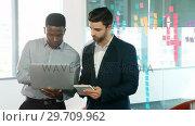 Купить «Male executives using laptop and digital tablet 4k», видеоролик № 29709962, снято 19 августа 2017 г. (c) Wavebreak Media / Фотобанк Лори