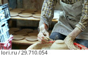 Купить «Male potter scrapping out the extra clay from the ceramic bowl 4k», видеоролик № 29710054, снято 6 августа 2017 г. (c) Wavebreak Media / Фотобанк Лори
