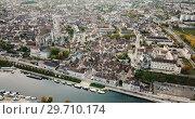 Купить «Aerial view of historic city of Auxerre on river Yonne with Roman Catholic Cathedral and ancient Abbey, Burgundy, France», видеоролик № 29710174, снято 24 октября 2018 г. (c) Яков Филимонов / Фотобанк Лори