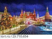 Купить «Новогодний праздник на Манежной площади New Year's holiday on Manezhnaya Square», фото № 29710654, снято 16 декабря 2018 г. (c) Baturina Yuliya / Фотобанк Лори