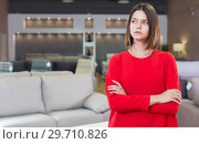 Купить «Portrait of woman in furniture salon», фото № 29710826, снято 29 октября 2018 г. (c) Яков Филимонов / Фотобанк Лори