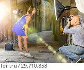 Купить «Professional photo shooting outdoors. Attractive female model po», фото № 29710858, снято 5 октября 2018 г. (c) Яков Филимонов / Фотобанк Лори