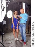 Купить «Photographer showing photos on camera to model girl», фото № 29710870, снято 5 октября 2018 г. (c) Яков Филимонов / Фотобанк Лори