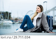 Купить «woman with luggage posing at quay and smiling», фото № 29711034, снято 27 марта 2017 г. (c) Яков Филимонов / Фотобанк Лори
