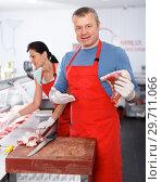 Купить «Smiling man and woman sellers working in shop», фото № 29711066, снято 22 июня 2018 г. (c) Яков Филимонов / Фотобанк Лори