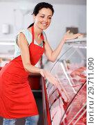 Купить «seller showing different meat in butcher's shop», фото № 29711090, снято 22 июня 2018 г. (c) Яков Филимонов / Фотобанк Лори