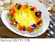 Купить «Raw salmon tartare with fruits, vegetables, flowers», фото № 29711178, снято 14 января 2019 г. (c) Яков Филимонов / Фотобанк Лори