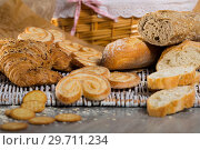 Купить «Wheat and grain baguettes, croissants and biscuits on wicker mat», фото № 29711234, снято 30 января 2018 г. (c) Яков Филимонов / Фотобанк Лори