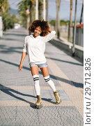 Купить «Black woman on roller skates rollerblading in beach promenade with palm trees», фото № 29712826, снято 20 декабря 2017 г. (c) Ingram Publishing / Фотобанк Лори