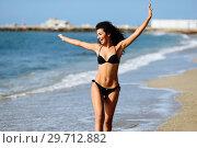 Купить «Young arabic woman with beautiful body in swimwear smiling on a tropical beach.», фото № 29712882, снято 24 сентября 2017 г. (c) Ingram Publishing / Фотобанк Лори