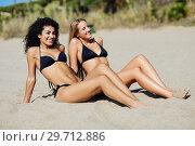 Купить «Two young women with beautiful bodies in swimwear on a tropical beach», фото № 29712886, снято 24 сентября 2017 г. (c) Ingram Publishing / Фотобанк Лори