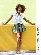 Купить «Young black woman, afro hairstyle, standing in urban background», фото № 29712954, снято 9 октября 2017 г. (c) Ingram Publishing / Фотобанк Лори