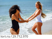 Купить «Two women in swimsuit having fun on the beach», фото № 29712970, снято 24 сентября 2017 г. (c) Ingram Publishing / Фотобанк Лори