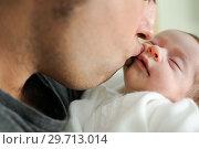 Father kissing his newborn baby girl. Стоковое фото, фотограф Javier Sánchez Mingorance / Ingram Publishing / Фотобанк Лори