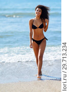 Купить «Young arabic woman with beautiful body in swimwear smiling on a tropical beach.», фото № 29713234, снято 24 сентября 2017 г. (c) Ingram Publishing / Фотобанк Лори