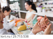 Купить «Woman hands receiving manicure», фото № 29713538, снято 28 апреля 2017 г. (c) Яков Филимонов / Фотобанк Лори