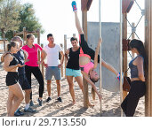 Купить «Girl performing pole exercises», фото № 29713550, снято 14 июня 2017 г. (c) Яков Филимонов / Фотобанк Лори