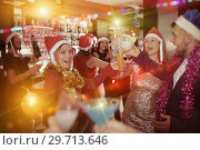 Купить «Man with females on corporate new year party in bar», фото № 29713646, снято 29 ноября 2017 г. (c) Яков Филимонов / Фотобанк Лори