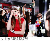 Купить «Girl upset because her boyfriend drinking too much on Hawaiian party», фото № 29713670, снято 29 ноября 2017 г. (c) Яков Филимонов / Фотобанк Лори