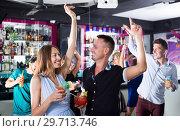 Купить «Students dancing on party in club», фото № 29713746, снято 2 августа 2017 г. (c) Яков Филимонов / Фотобанк Лори