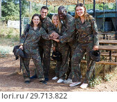 Купить «Positive team of players wearing camouflage», фото № 29713822, снято 11 августа 2018 г. (c) Яков Филимонов / Фотобанк Лори