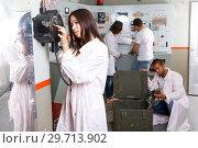 Купить «Girl talking on old telephone in quest room», фото № 29713902, снято 8 октября 2018 г. (c) Яков Филимонов / Фотобанк Лори