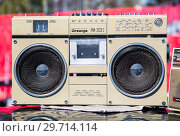 Купить «Vintage radio cassette recorder and player with music tape cassette», фото № 29714114, снято 12 июня 2017 г. (c) FotograFF / Фотобанк Лори