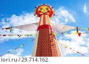 Купить «Big doll for the burning on the blue sky background», фото № 29714162, снято 17 февраля 2018 г. (c) FotograFF / Фотобанк Лори
